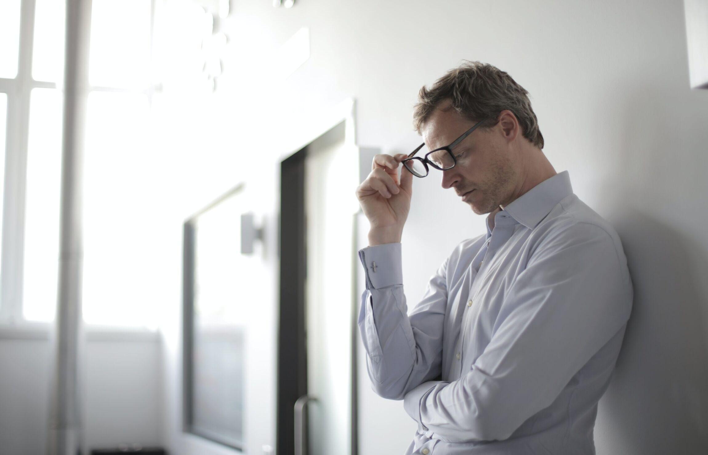 photo-of-man-holding-black-eyeglasses-